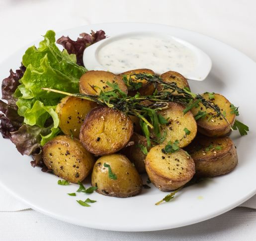 Baked Potatoes with Garlic Sauce